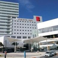 Logo_Fiesta-Inn_NEW-LOGO_MX_2631759-Fiesta-Inn-Cancun-Las-Americas-Hotel-Exterior-1-DEF
